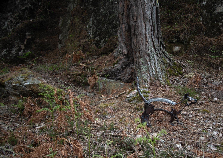 cat sculpture in woods